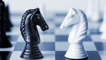 Chess pieces; God vs. Satan.
